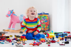 Little boy playing with toy cars Royalty Free Stock Images