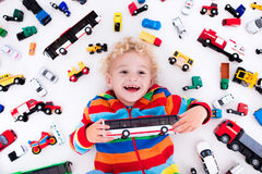 Little boy playing with toy cars Royalty Free Stock Image