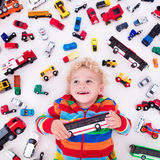 Little boy playing with toy cars Stock Photography