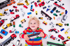 Little boy playing with toy cars Stock Photo