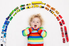 Little boy playing with toy cars. Toys for kids. Stock Images