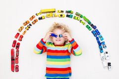 Little boy playing with toy cars. Toys for kids. Stock Image