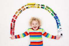 Little boy playing with toy cars. Toys for kids. Stock Photography