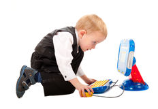 Little boy playing with a toy computer royalty free stock photos