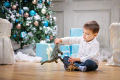 Little boy playing with a toy dinosaur Stock Photos