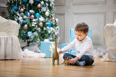 Little boy playing with a toy dinosaur Royalty Free Stock Images