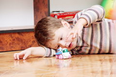 Little Boy Playing with Toy Helicopter Stock Photos