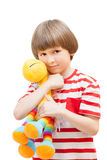 Little boy playing with a toy horse Royalty Free Stock Photos