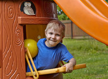 Little boy playing in toy house Royalty Free Stock Images