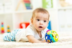 Little boy playing with toy at nursery Stock Images