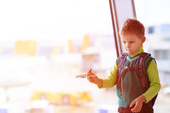 Little boy playing with toy plane in the airport Royalty Free Stock Photography