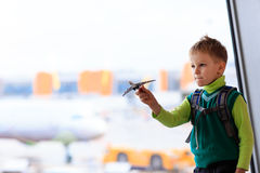 Little boy playing with toy plane in the airport Royalty Free Stock Images