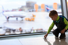 Little boy playing with toy plane in the airport. Kids travel Royalty Free Stock Photos