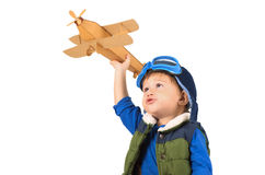 Little boy playing with toy plane. Little boy playing with handmade cardboard toy plane isolated on white background Stock Photos