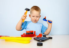 Little boy playing with toy tool Royalty Free Stock Image