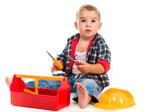 Little boy playing toy tools Royalty Free Stock Images