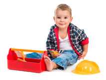 Little boy playing toy tools Stock Photos