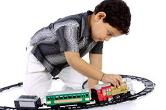 Little boy playing with toy train Stock Photo