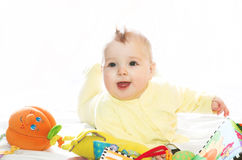 Little boy playing with toys. Wearing yellow suit Stock Images