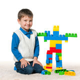 Little boy is playing with toys Stock Image