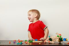 Little boy playing with toys having fun. Childhood, kids imagination concept. Concentrated little boy playing with toys having fun Stock Image