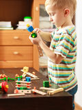 Little boy playing with toys having fun Stock Photos