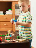 Little boy playing with toys having fun Stock Photo