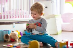 Little boy playing with toys. At home Stock Photography