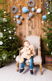 Little boy playing with toys near Christmas tree Stock Photography