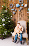 Little boy playing with toys near Christmas tree Stock Image