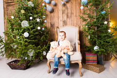 Little boy playing with toys near Christmas tree Royalty Free Stock Images