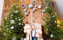 Little boy playing with toys near Christmas tree Royalty Free Stock Photos