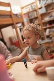 Little boy playing with toys in the room Royalty Free Stock Image