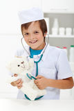Little boy playing veterinary doctor Royalty Free Stock Photography