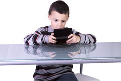 Little Boy Playing Video Games Royalty Free Stock Photo