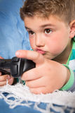 Little boy playing video games. Beautiful Little boy playing video games Royalty Free Stock Image