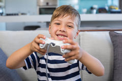 Little boy playing video games. At home in the living room Royalty Free Stock Photography