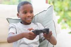 Little boy playing video games Royalty Free Stock Image