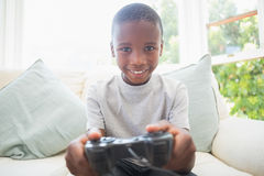 Little boy playing video games. At home in the living room Royalty Free Stock Image