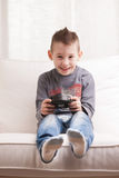 Little boy playing video games Stock Image