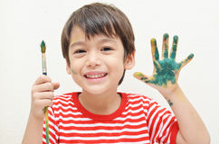 Little boy playing water color with color in hand Stock Photography