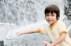Little boy playing water fountain Royalty Free Stock Photography