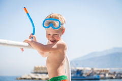 Little boy playing in the water Stock Images