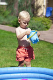 Little boy playing with water near the children's pool on the la Royalty Free Stock Images