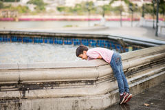 Little boy playing water over fountain outdoor Royalty Free Stock Images