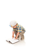 Little boy playing white a book Stock Photography