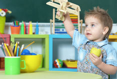 Little Boy Playing With Toy Stock Image