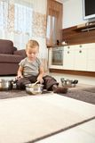 Little boy playing withcooking pots Royalty Free Stock Photo
