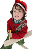 Little boy playing with wood Stock Photos