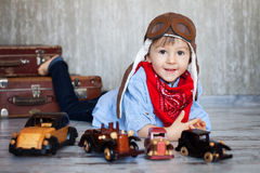 Little boy, playing with wooden cars Royalty Free Stock Image